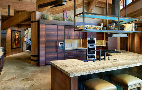 Ascent Group provide structural engineering for this rustic custom mountain kitchen with large open timber framing above it and large stone flooring
