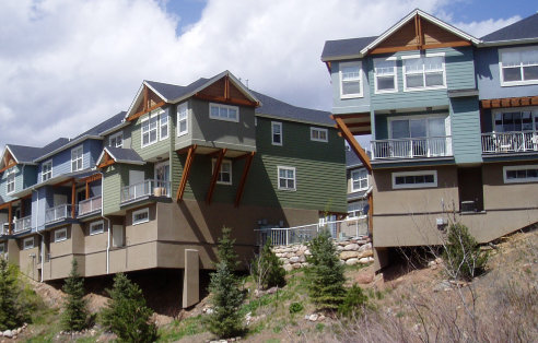 Three story rear view of colorado mountain townhomes