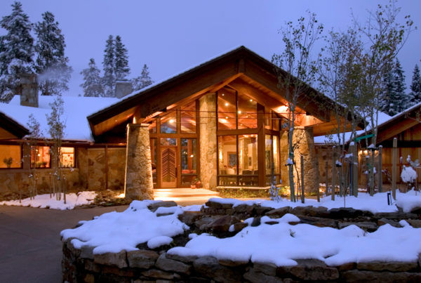front view of a custom home in Breckenridge, Colorado in a snowy mountain setting