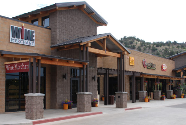 nature's oasis grocery store with open timber beams and colorado mountain style architecture
